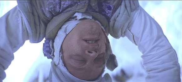Luke Skywalker upside down in the wampa's ice cave