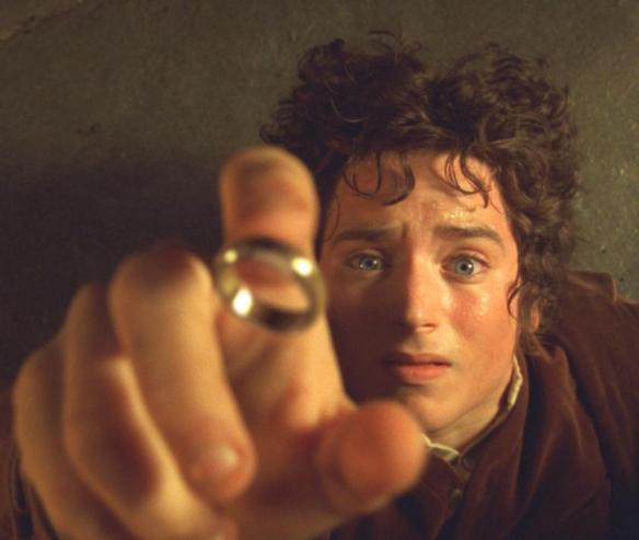 Frodo putting on the Ring at the Prancing Pony